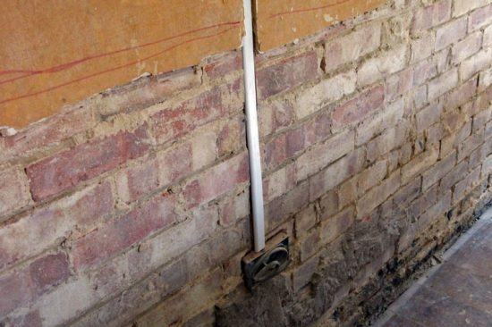 Removing external plaster to fix rising damp problems
