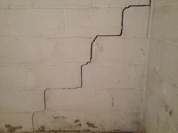 Cracked basement walls need repairing before waterproofing them