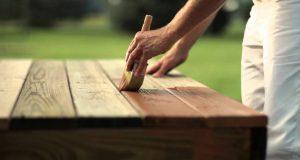 Applying wood oil by brush