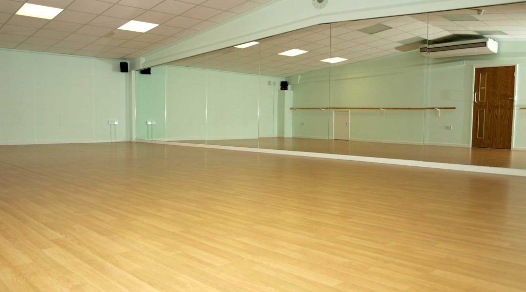 Polyurethane varnish being used on a dance studio floor