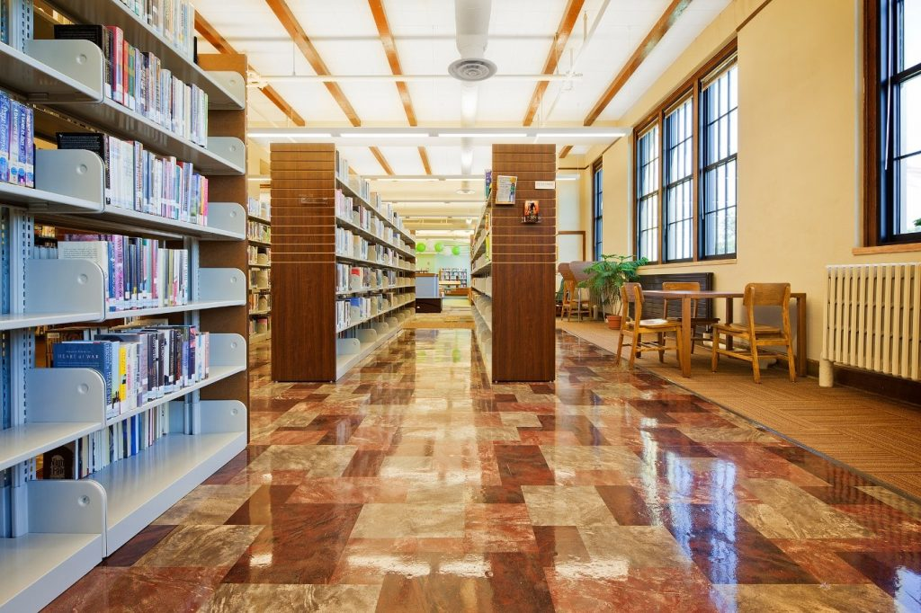 Polyurethane varnish being used on a library floor